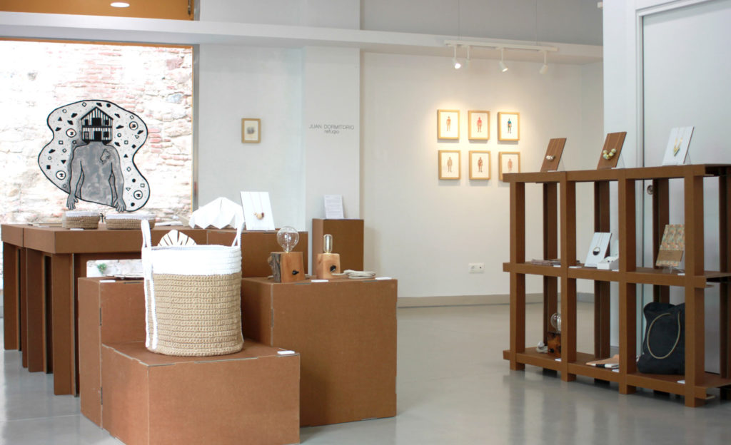 matraca interiorismo comercial sostenible ecologico muebles carton concept store malaga